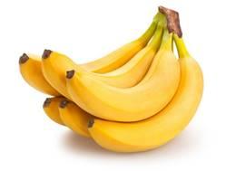 一張含有 香蕉, 水果, 桌, 坐 的圖片自動產生的描述